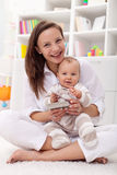Baby girl reading her first book with mother Stock Photo