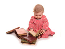 Baby girl reading some books. Cutout Stock Photo
