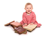 Baby girl reading some books. Cutout Royalty Free Stock Photos