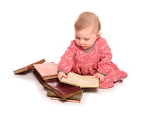 Baby girl reading some books. Cutout Stock Images