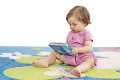 Baby Girl Reads Royalty Free Stock Image