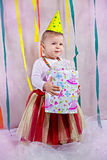 Baby girl with present Royalty Free Stock Photo