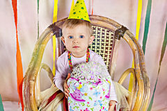 Pretty baby girl with birthday present Stock Image