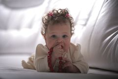 Baby girl with red beads Royalty Free Stock Photo
