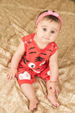 Baby girl with red clothes Stock Photo