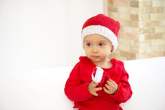Baby girl in red costume, Royalty Free Stock Images