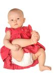 Baby girl in red dress. (6 month), isolated on white background Royalty Free Stock Image