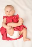Baby girl in red dress Stock Photos