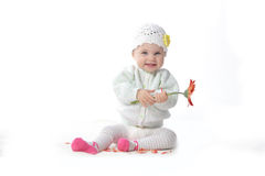 Baby girl with red flower. Cute baby girl playing with red flower royalty free stock photography