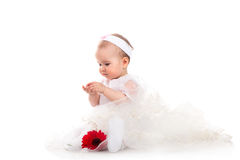 Baby girl with red flower. Pretty baby girl with red flower Stock Photos
