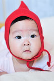 Baby girl with red hat Stock Photography