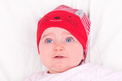 Baby girl with red hat. Royalty Free Stock Photography