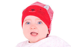 Baby girl with red hat. Stock Photos