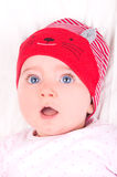 Baby girl with red hat. Royalty Free Stock Photo