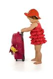Baby girl in red with luggage - isolated. Little girl in purple dress and hat, holding a purple luggage (isolated, with a bit of shadow, clipping path Stock Photos