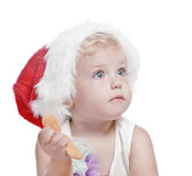 Baby girl in a red new year cap Stock Photography
