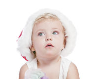 Baby girl in a red new year cap Stock Images