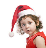 Baby girl in a red new year cap. Isolated Stock Image