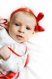 Baby girl with red ribbon Stock Image