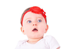 Baby girl with red ribbon. Royalty Free Stock Photo