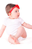 Baby girl with red ribbon. Stock Images