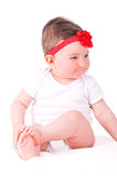 Baby girl with red ribbon. Stock Photography