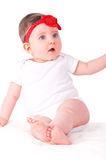 Baby girl with red ribbon. Royalty Free Stock Photography