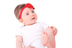 Baby girl with red ribbon. Stock Photos