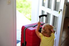 Baby girl with red suitcase royalty free stock photography
