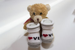 Baby Girl - Red and white socks with bear on white background royalty free stock photo