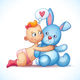 Baby girl redhead hugs bunny toy on a white Stock Images