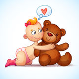 Baby girl redhead hugs Teddy Bear toy on a white Royalty Free Stock Photography