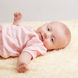 Baby Girl in Relaxed Pose Royalty Free Stock Images