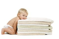 Baby girl resting head on towels Royalty Free Stock Image