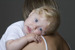 Baby Girl Resting In Mother's Arm Stock Photography