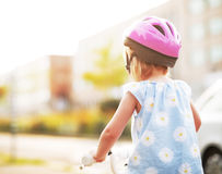 Baby girl riding bicycle Stock Photo
