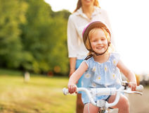 Baby girl riding bicycle Royalty Free Stock Images