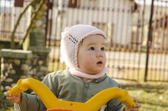 Baby girl riding her bike Royalty Free Stock Photography