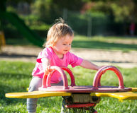 Baby girl riding on a swing Stock Image