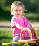 Baby girl riding on a swing Royalty Free Stock Photo