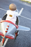 Baby Girl Riding In Toy Aeroplane Stock Photo