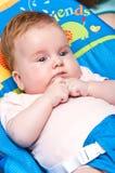 Baby girl in rocker Stock Images