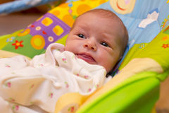 Baby girl in rocker Royalty Free Stock Photo