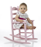 Baby girl in rocking chair Stock Photo