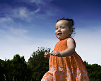 Baby girl running. Through the park Royalty Free Stock Image