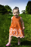 Baby girl running. Through the park Stock Photos