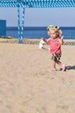 Baby girl running on the beach Stock Photo