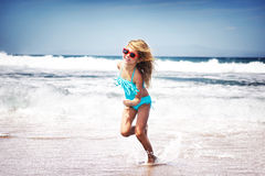 Baby girl running on a beach Royalty Free Stock Photography