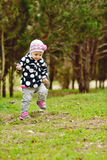 Baby girl is running Royalty Free Stock Photography