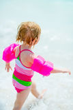 Baby girl running at seaside Royalty Free Stock Photo